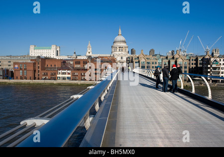People on the Millenium Bridge in London.  Photo by Gordon Scammell - Stock Photo