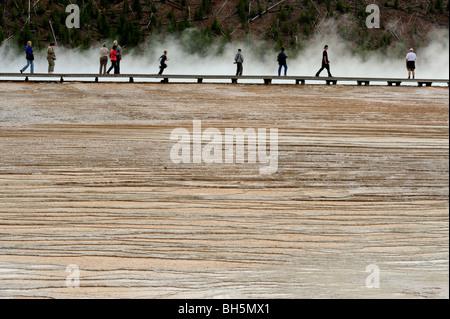Tourists on boardwalk near Grand Prismatic Spring, Yellowstone National Park, Wyoming - Stock Photo