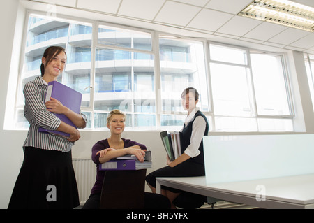 Portrait of three office girls. - Stock Photo