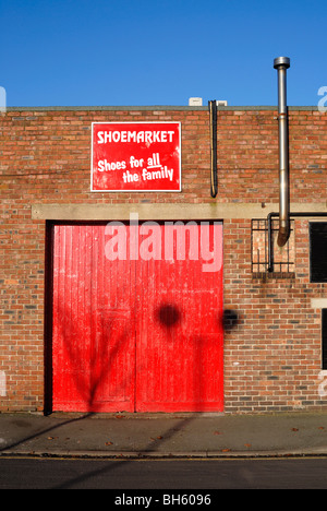 Bright red doors and red and white 'Shoemarket' sign. - Stock Photo