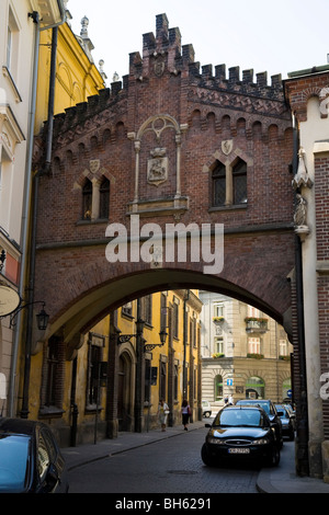 Bridge over Pijarska street near the Czartoryski Palace (Muzeum Czartoryskich) / Czartoryski Museum, Krakow, Poland. - Stock Photo