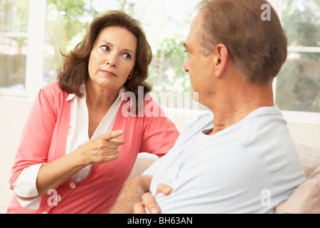 Senior Couple Having Arguement At Home - Stock Photo