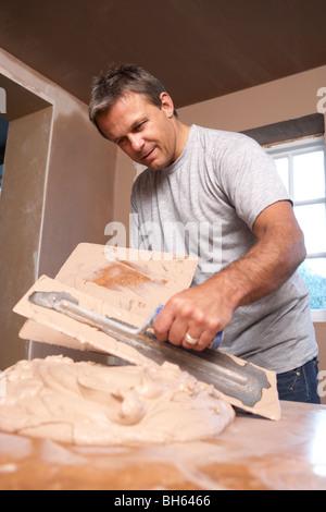 Plasterer Mixing Plaster - Stock Photo