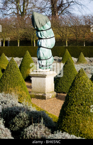 Statue wrapped up for protection from frost, in the formal garden to the east side of the Ham House. Ham House, - Stock Photo