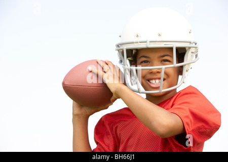 Young Boy Playing American Football - Stock Photo