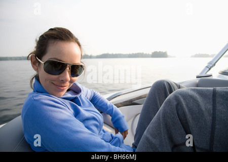 Woman relaxing in boat - Stock Photo
