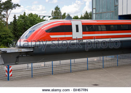 Transrapid TR09 maglev train looking out of maintenance hall monorail magnetic levitation elevated track Lathen - Stock Photo