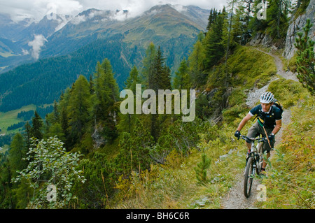 Mountain-biker on Alpine singletrack high above Davos in the Swiss canton of Grisons/Graubunden - Stock Photo