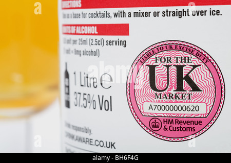 HM Revenue & Customs liable to UK excise duty label printed on a bottle of Vodka - Stock Photo