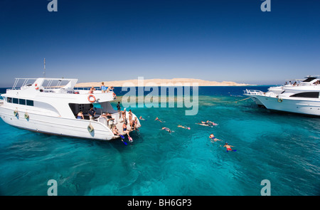 Tourist dive boats at sea - Stock Photo