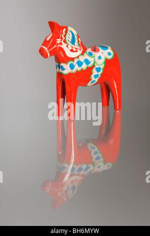 A Traditional Dalecarlian horse or Dala horse (Swedish: Dalahäst) - Stock Photo