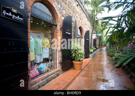 Retail shops along an alley in Charlotte Amalie, St. Thomas, USVI. - Stock Photo