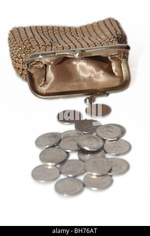 Financial concept  poor, empty, purse,  silver coins - Stock Photo