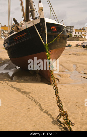 The Dolly Pentreath, a sail boat moored up on St Ives beach in Cornwall - Stock Photo