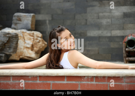 Woman smiling in bath - Stock Photo