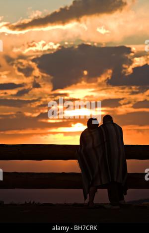 Couple watches the sun set over Cedar Breaks National Monument - Stock Photo