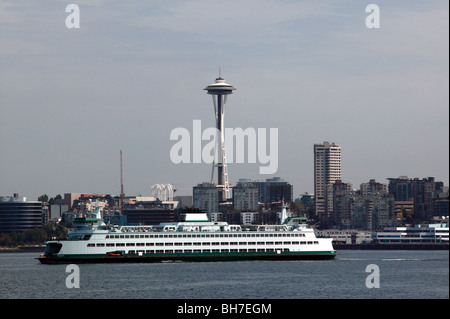A large passenger and car ferry (MV Wenatchee), passes infront of the Space Needle, in Elliot Bay, Seattle - Stock Photo