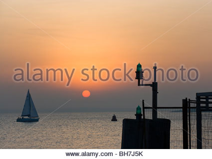 Sail Boat And Sunset From Pier Southsea England - Stock Photo