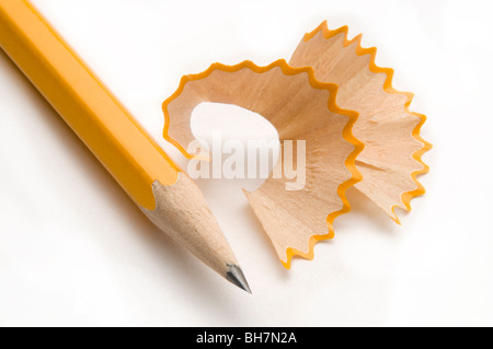 yellow pencil with shavings - Stock Photo
