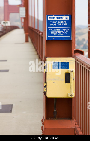 Crisis Counseling Sign for Suicide Prevention on Golden Gate Bridge, San Francisco, California, US - Stock Photo