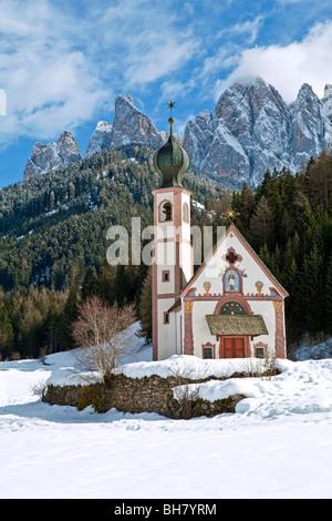 Winter landscape of St Johann Church, Ranui in Villnoss, Val di Funes, Dolomites mountains, Trentino-Alto Adige, - Stock Photo