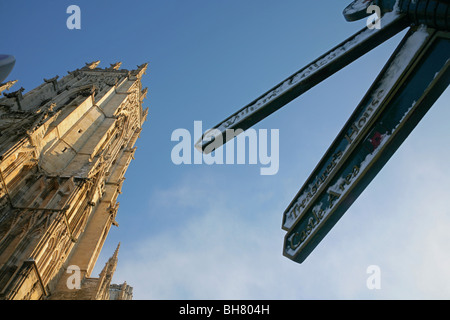 Tourist signpost outside the West face of the Minster, York, North Yorkshire, England. - Stock Photo