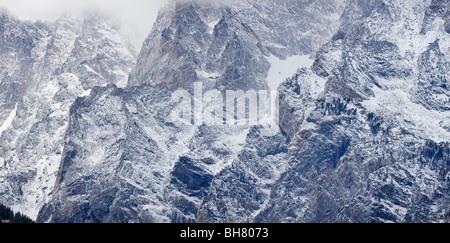 Sheer cliffs on Mount Moran in the Teton Range near Jenny Lake after a light October snowfall. - Stock Photo