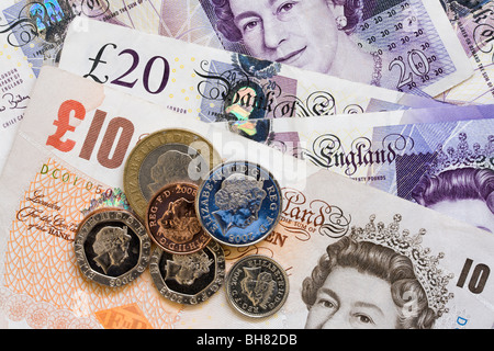 Money £10 and £20 old paper banknotes and coins. England UK Britain. - Stock Photo