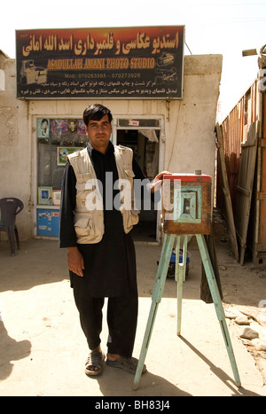 Afghan photographer outside his studio on the outskirts of Kabul Afghanistan - Stock Photo