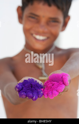 Happy young indian boys holding coloured powder in his hands at holi festival. India - Stock Photo
