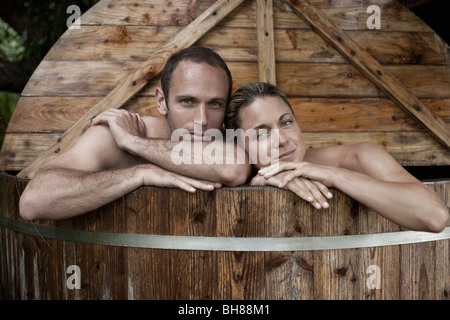 A couple in a health spa hot tub - Stock Photo