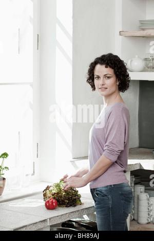 A woman preparing vegetables - Stock Photo