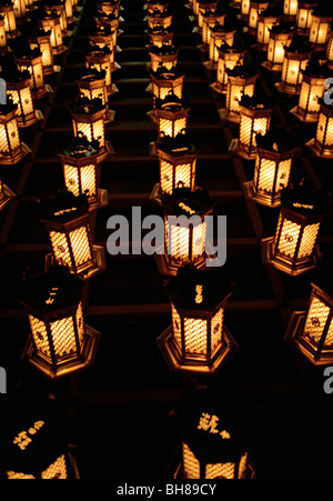 Illuminated lanterns arranged in rows, Miyajima, Japan - Stock Photo