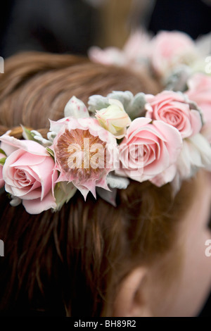 Rear view detail of a girl wearing a floral wreath - Stock Photo
