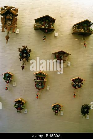 Cuckoo clocks on a wall - Stock Photo