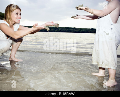 Mother and child dirty hands - Stock Photo