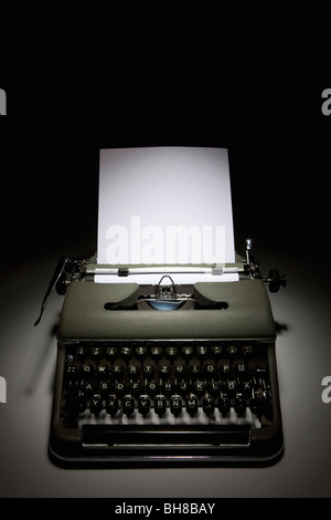 An old-fashioned typewriter with paper - Stock Photo