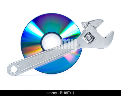 Technical support, fixing problems icon. A spanner and a digital disc. - Stock Photo