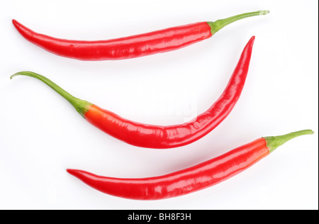 Pods spicy red chilli peppers on white background - Stock Photo