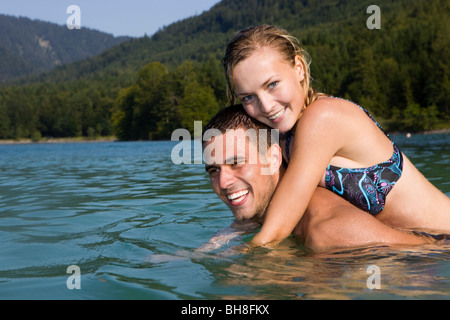 A couple having fun in the water - Stock Photo