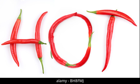the word 'HOT' is lined with red chilli pepper - Stock Photo