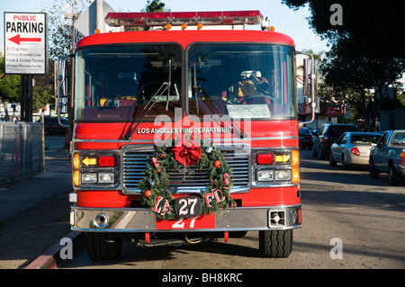 Christmas wreath in front of a Fire truck, Los Angeles Fire Department, Hollywood, Los Angeles, California, USA - Stock Photo