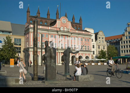 Statues and Town Hall at Neuer Markt in Rostock in Mecklenburg-West Pomerania, Germany - Stock Photo