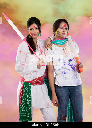 Women posing with pichkaris - Stock Photo
