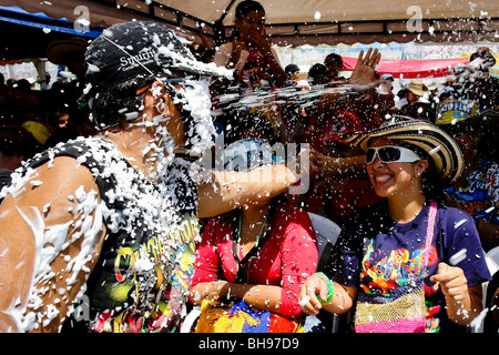 The foam battle during the Carnival of Barranquilla 2006, Colombia. - Stock Photo