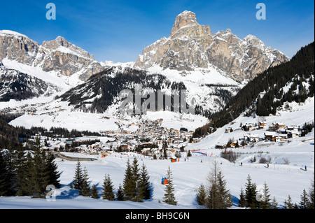 View over the resort of Corvara with Colfosco in the distance, Sella Ronda Ski Area, Alta Badia, Dolomites, Italy - Stock Photo