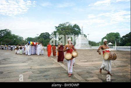 A  parade at Ruwanweliseya (Dagoba) Anuradhapura Sri Lanka - Stock Photo