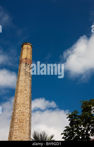 A brick chimney at the rum distillery at St Nicholas Abbey on the Caribbean island of Barbados - Stock Photo