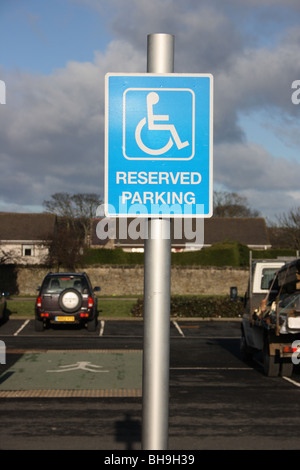 Reserved parking sign for disabled drivers in a UK supermarket carpark. - Stock Photo