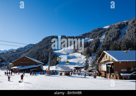 The Tougnete and Soulire telecabine lifts in the centre of Meribel, Three Valleys, Tarentaise, Savoie, France - Stock Photo